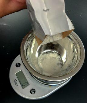 Kids weighing flour for Jamie Oliver Easy Rustic Gnocchi on eatlivetravelwrite.com