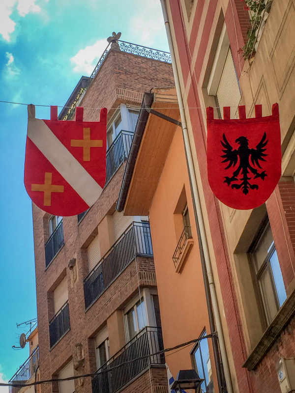Flags in the streets of Najera on the Camino de Santiago on eatlivetravelwrite.com