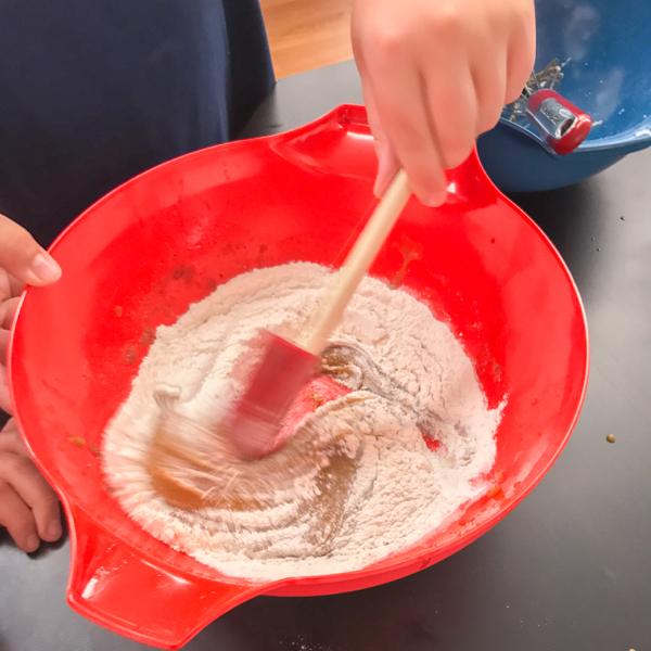 Stirring ingredients into wet making blondies on eatlivetravewrite.com