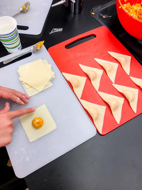 Kids making roasted squash ravioli on eatlivetravewrite.com