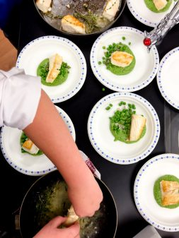 Plating up a Ned Bell dish with Les Petits Chefs on eatlivetravelwrite.com