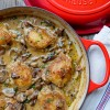 Braised chicken with creamy mushroom sauce in Le Creuset braiser on eatlivetravelwrite.com