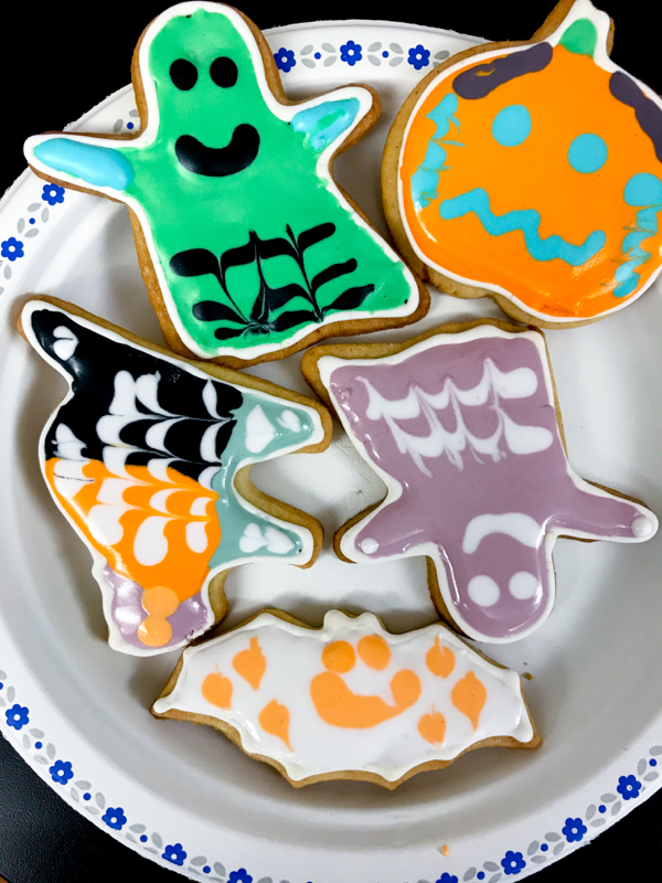 Plate of Halloween cookies decorated by kids with Adell Shneer on eatlivetravelwrite.com