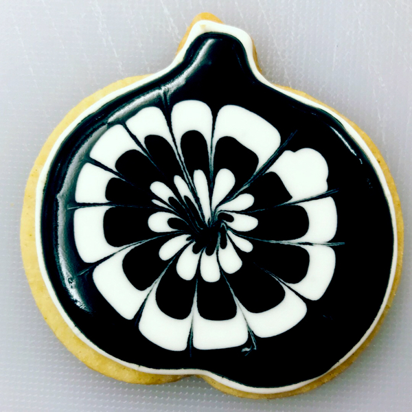 Black and white pumpkin cookie decorated by kids with Adell Shneer on eatlivetravelwrite.com