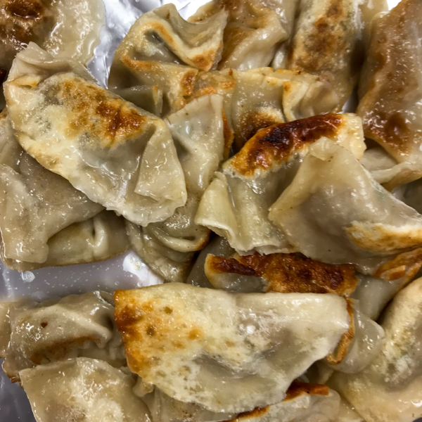 Pan fried dumplings by Vanessa Yeung on eatlivetravelwrite.com