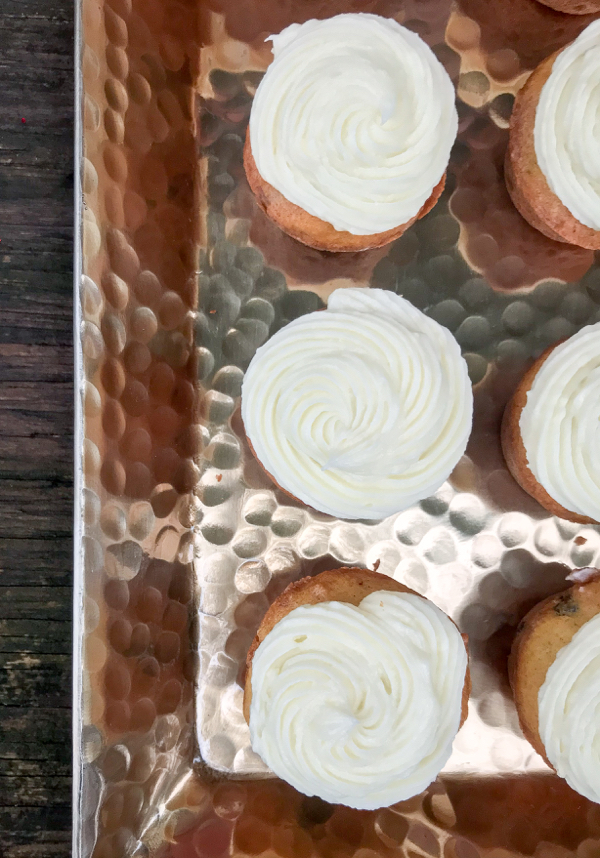 Pumpkin cupcakes with cream cheese frosting on eatlivetravelwrite.com