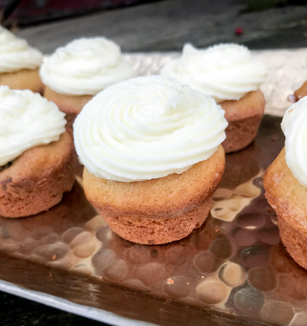 Pumpkin cupcakes with cream cheese icing on eatlivetravelwrite.com