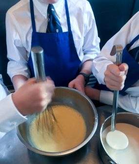 Kids tempering eggs with warm cream at the Gallery Grill on eatlivetravelwrite.com