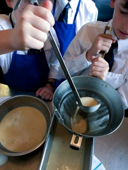 Kids straining custard at the Gallery Grill on eatlivetravelwrite.com