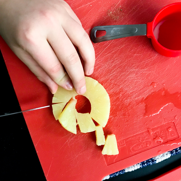 Chopping pineapple to make Hawaiian pizza muffins with Ceri Marshon eatlivetravelwrite.com