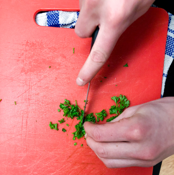 Kids chopping parsley with Emily Richards on eatlivetravelwrite.com