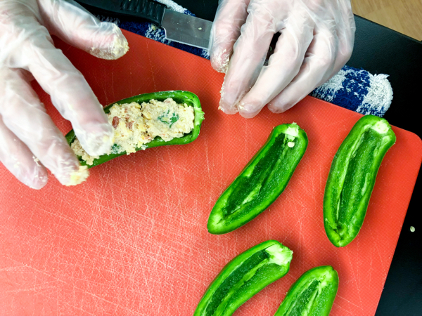 Kids stuffing jalapeno peppers with Emily Richards on eatlivetravelwrite.com