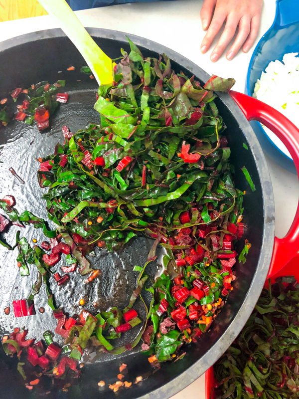 Chard in the pan cooking for Orecchiette Pasta with Chard from Bringing it Home on eatlivetravelwrite.com