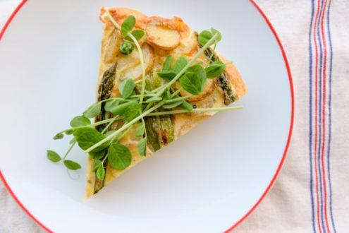 Slice of frittata with potatoes, asparagus and peas on eatlivetravelwrite.com