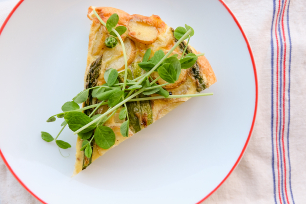 Slice of frittata with potatoes, asparagus and peas on eatlivetravelwrite.com
