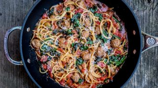 One pot spaghetti and sausage meatballs with tomatoes and kale