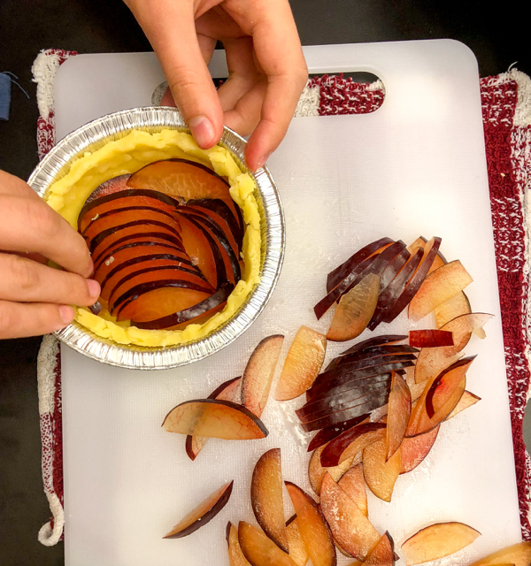 Kids assembling Caramalized Plum Tarts from Clotilde Dusoulier Tasting Paris on eatlivetravelwrite.com
