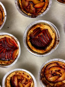 Caramelized plum tarts just out of the oven on eatlivetravelwrite.com