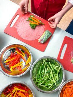 Assembling Rainbow Rice Paper Rolls from Vegetarian Vietnam on eatlivetravelwrite.com