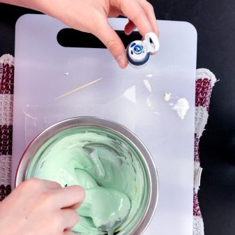 Mixing green frosting for decorating cookies with Adell Shneer on eatlivetravelwrite.com