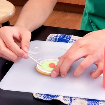 Circle art swirling icing for decorating cookies with Adell Shneer on eatlivetravelwrite.com