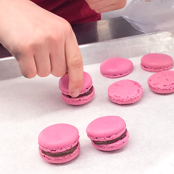 Kids topping macarons at Nadege in Toronto on eatlivetravelwrite.com