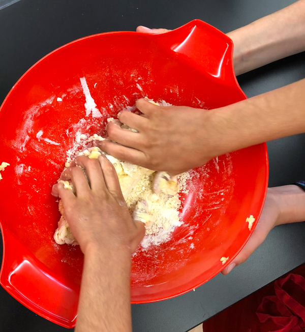 Kneading dough for pasta from scratch wth Emily Richards on eatlivetravelwrite.com