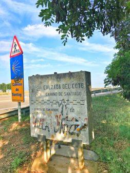 Camino signage walking from Sahagun to El Burgo Ranero on the Camino de Santiago on eatlivetravelwrite.com
