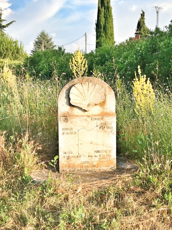 Old Camino waymarker walking from Carrión de los Condes to Calzadilla de la Cueza on eatlivetravelwrite.com