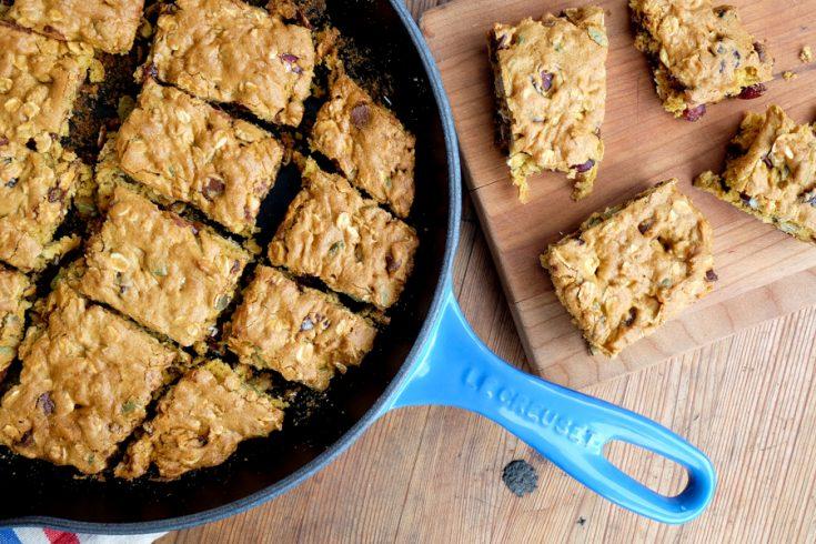 Squares of Pumpkin Granola Snack Cake in Le Creuset Blueberry Skillet on eatlivetravelwrite.com