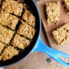 Squares of Pumpkin Granola Snack Cake in Le Creuset Blueberry Skillet on eatlivetravelwrite.com