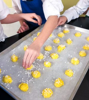 Kids making chouquettes from In the French kitchen with kids on eatlivetravelwrite.com