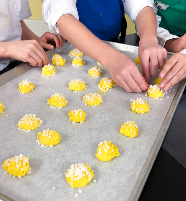 Adding sugar - making chouquettes from In the French kitchen with kids on eatlivetravelwrite.com