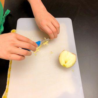 Kids mince garlic on eatlivetravelwrite.com