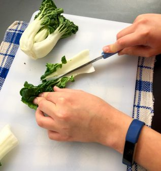 Slicing bok choy on eatlivetravelwrite.com
