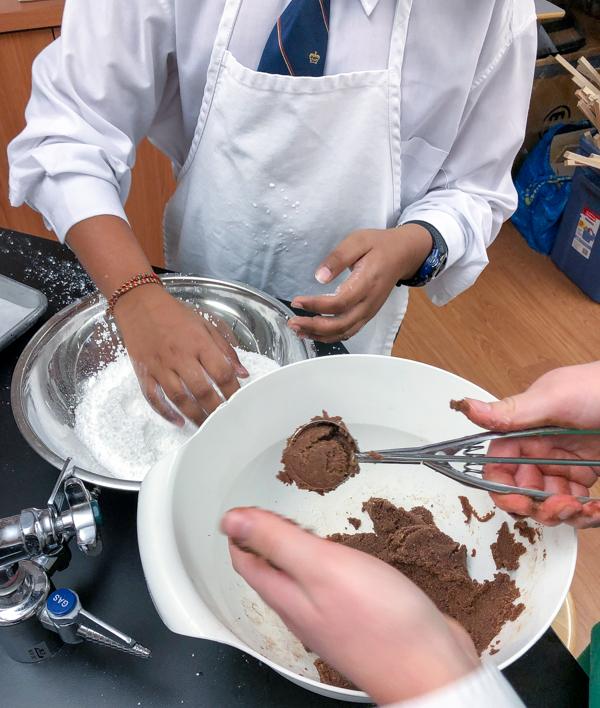 Kids rolling Chocolava Cookies for the holidays on eatlivetravelwrite.com