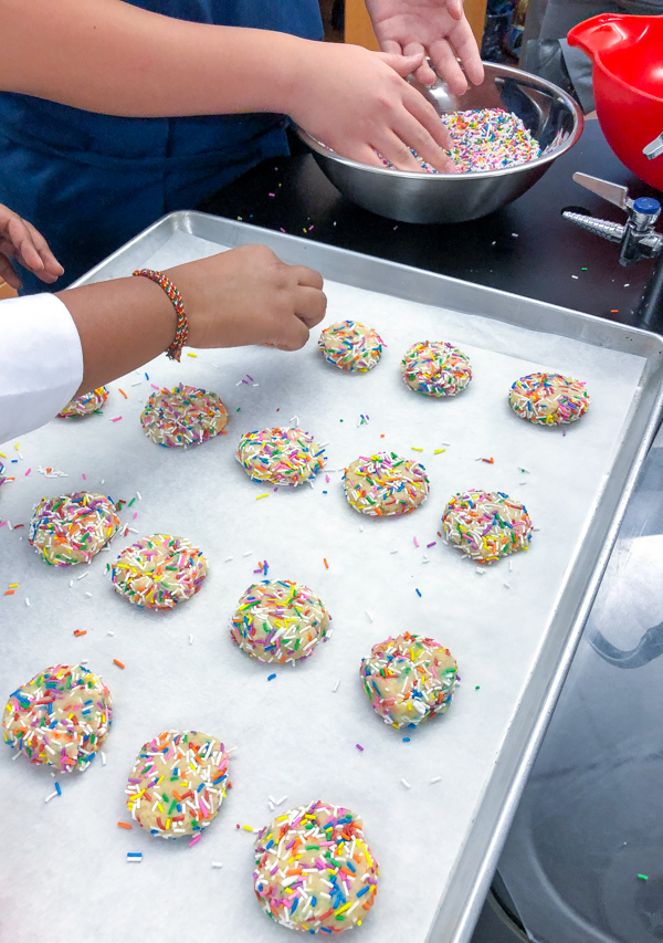 Kids bake Confetti Cookies for the holidays on eatlivetravelwrite.com
