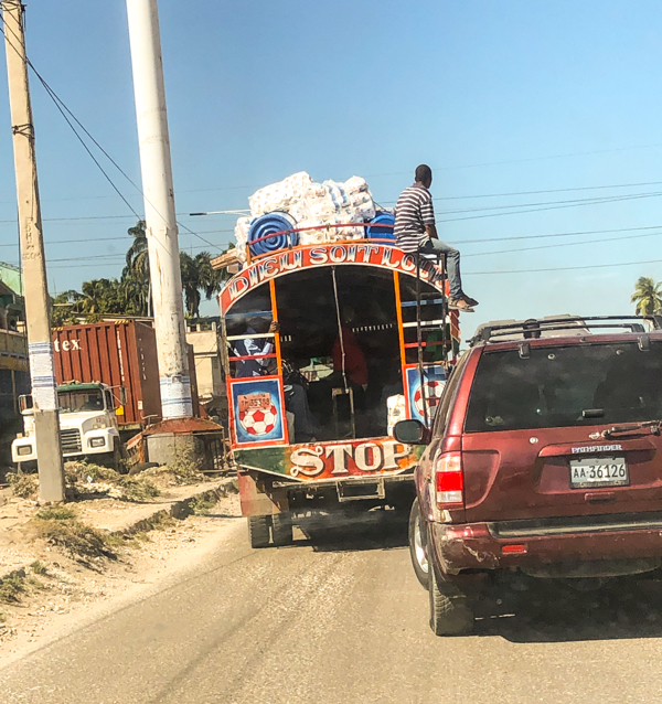 Lots of traffic on the road in Haiti on eatlivetravelwrite.com