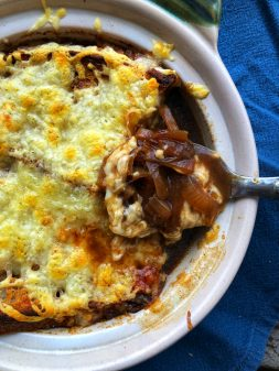 A spoon of David Lebovtiz French onion soup from My Paris Kitchen on eatlivetravelwrite.com