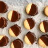 Chocolate dipped Speculoos filled Dorie Greenspan Good Better Best Cookies from Dorie's Cookies on eatlivetravelwrite.com