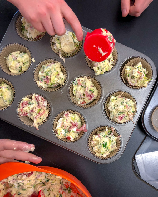 Kids scooping Zucchini, Ham and Goat Cheese Muffins from French Appetizers on eatlivetravelwrite.com