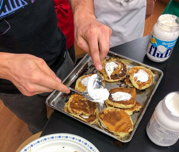 Adding marshmallow fluff to Smores Pancakes from Brunch LIfe with Matt Basile on eatlivetravelwrite.com