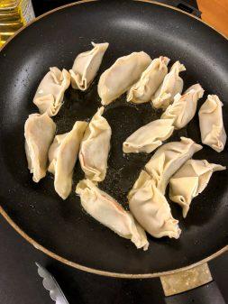 Shallow frying potstickers with Vanessa Yeung on eatlivetravelwrite.com