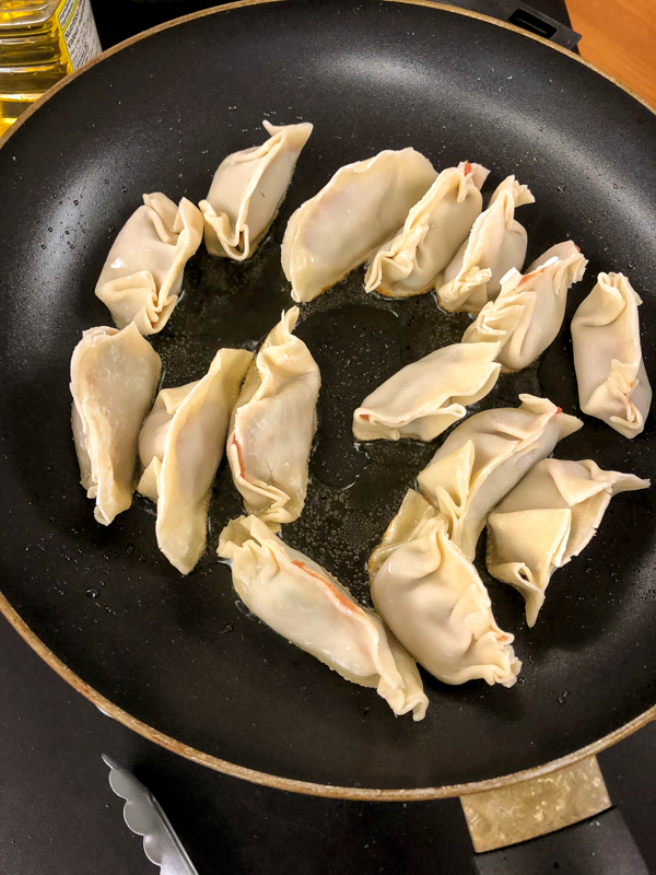 Shallow frying potstickers with Vanessa Yeung on eatlivetravelwrite.com