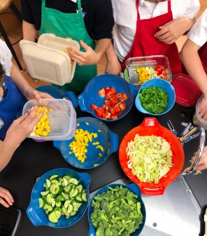 Kids plating up Chopped Thai Salad from Modern Lunch by Allison Day on eatlivetravelwrite.com