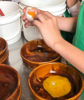 Separating eggs to make ice cream at the Gallery Grill with Chef Suzanne Baby on eatlivetravelwrite.com