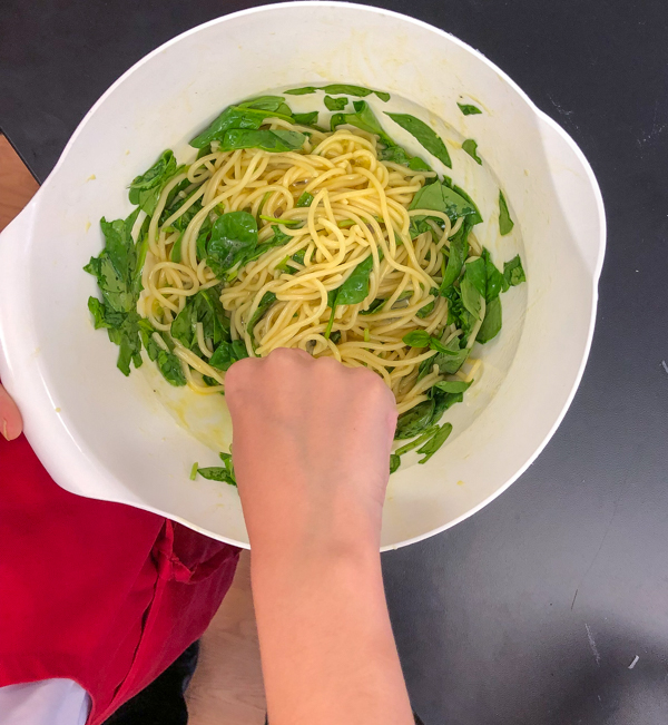 Whisking ingredients for Bacon spinach and spaghetti frittata from Weekday Suppers by Emily Richards on eatlivetravelwrite.com