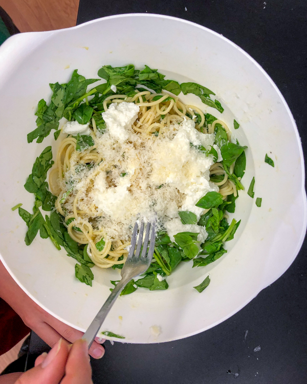Adding Parmesan to Bacon spinach and spaghetti frittata from Weekday Suppers by Emily Richards on eatlivetravelwrite.com
