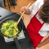 Checking to see if its done making Bacon spinach and spaghetti frittata from Weekday Suppers by Emily Richards on eatlivetravelwrite.com