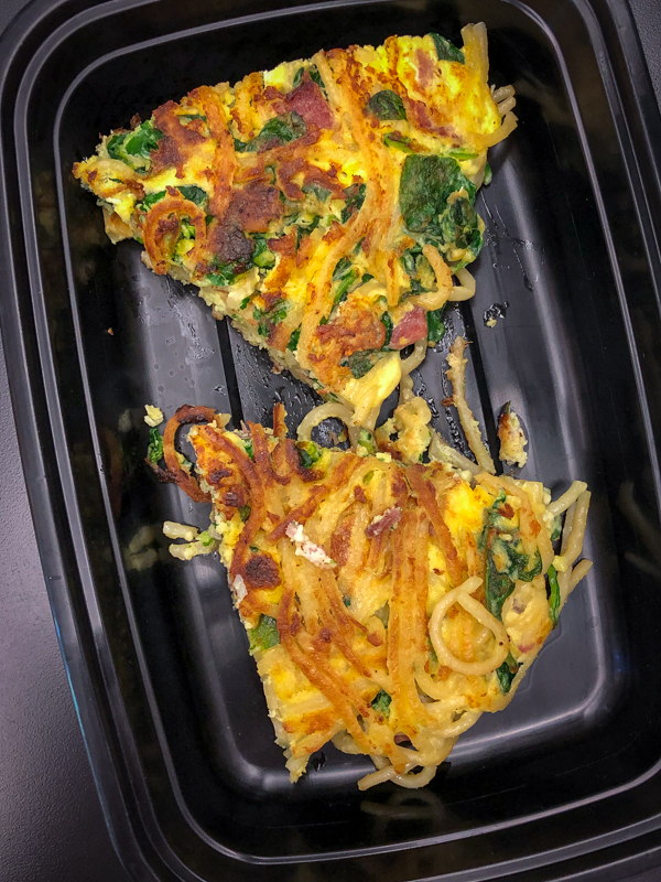 Slices of Bacon spinach and spaghetti frittata from Weekday Suppers by Emily Richards on eatlivetravelwrite.com